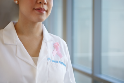 Body Fatness Affects Chemo Dosages, Contributing To Increased Risk of Breast Cancer Death photo of cancer care physician wearing pink ribbon