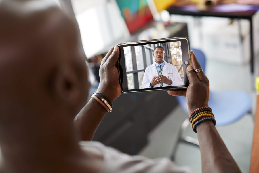 COVID-19 Pandemic Brings Telehealth Center Stage for Oncologists and Their Patients photo of patient on telehealth call with physician
