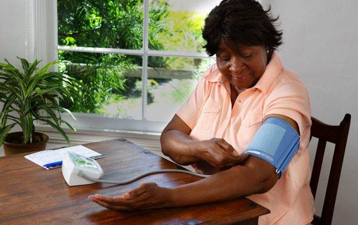 Transforming Health Care in the Age of Pandemic patient checking blood pressure at home