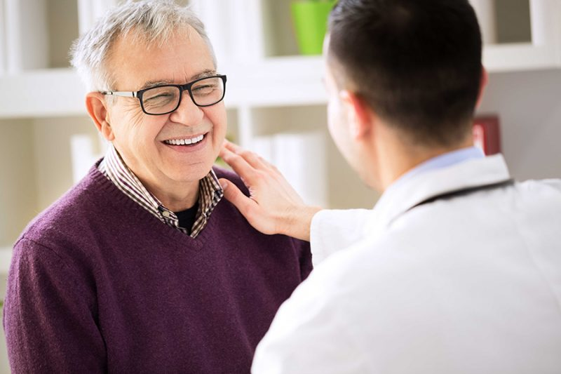 photo of doctor and mature male patient