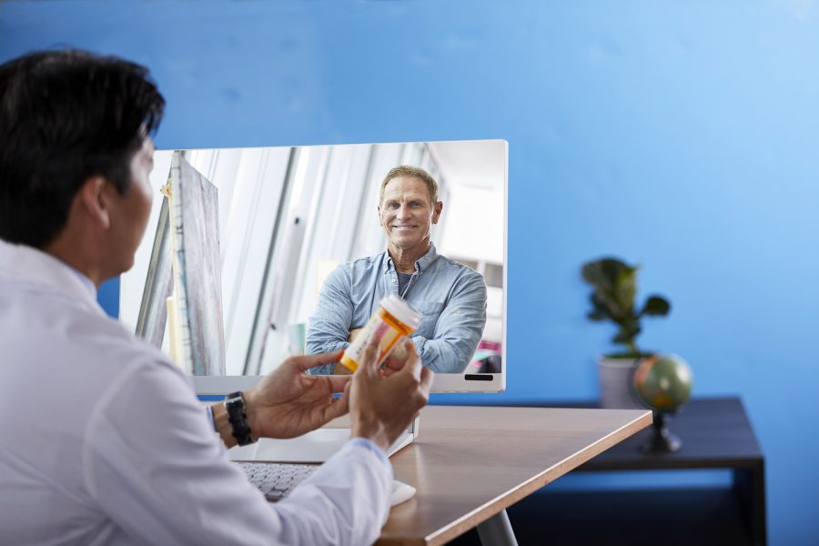 man and physician holding a prescription drug