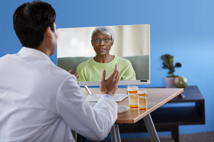 Pharmacist on a telehealth call with female patient