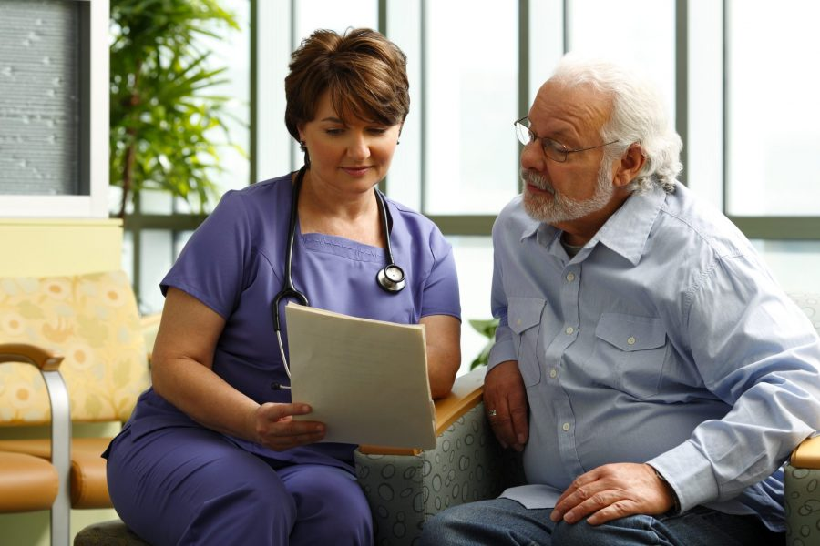 photo medical professional and patient reviewing information